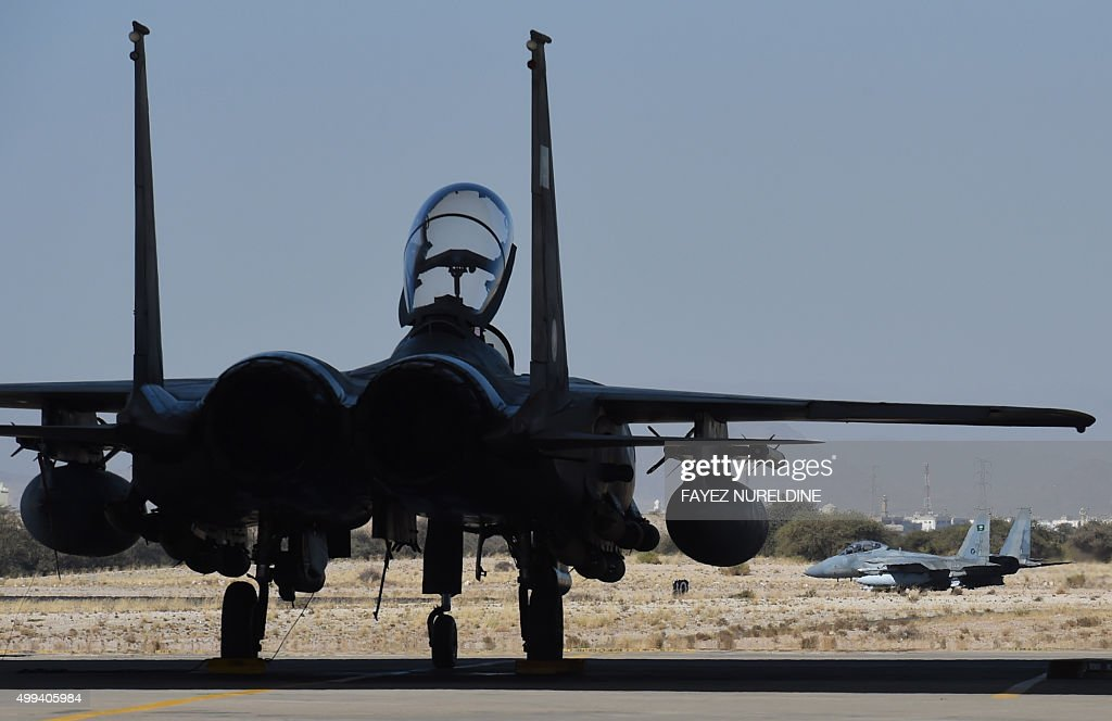 A picture taken on November 16 2015 shows Saudi F15 fighter jets preparing to take off for operations over Yemen at the Khamis Mushayt military...