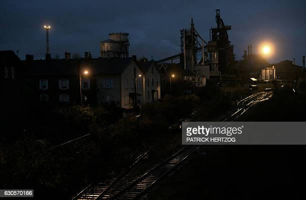 A picture taken on November 16 2016 shows the blast furnaces of the steel plant at night in Hayange eastern France / AFP / PATRICK HERTZOG