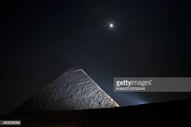 A picture taken on November 16 shows the moon above a pyramid in Giza on the outskirts of Cairo AFP PHOTO / KHALED DESOUKI