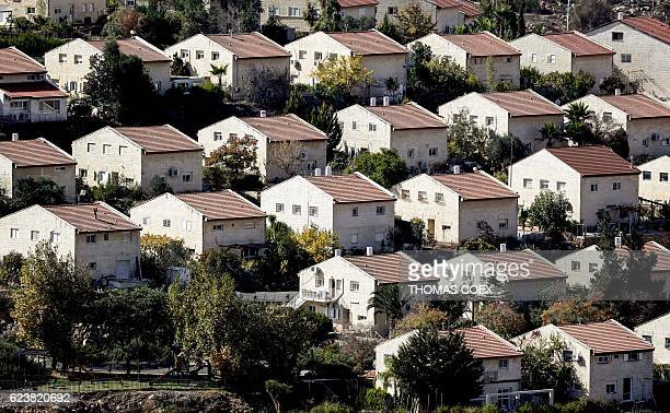 TOPSHOT A picture taken on November 17 2016 shows a general view of houses in the settlement of Ofra in the Israelioccupied West Bank established in...