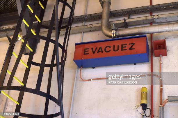 A picture taken on November 18 2016 shows a sign reading ' Evacuate ' in the reactor building of the nuclear power plant in Cattenom eastern France...
