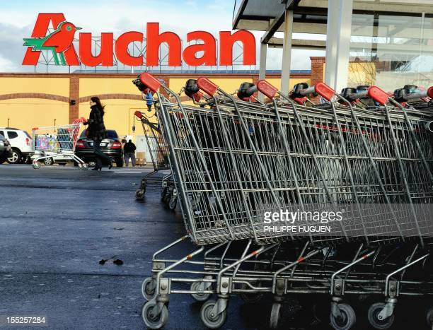 A picture taken on November 2 2012 shows shopping trolleys outside a supermarket of The French retail giant Auchan in Englos northern France AFP...