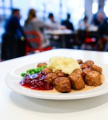A picture taken on November 2 2014 in Stockholm shows a traditional Swedish dish Swedish meatballs with mashed potatoes peas lingonberry jam and...