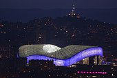 A picture taken on November 2 2014 shows the illuminated new Velodrome Stadium at sunset in Marseille southern France The Stade Velodrome which...