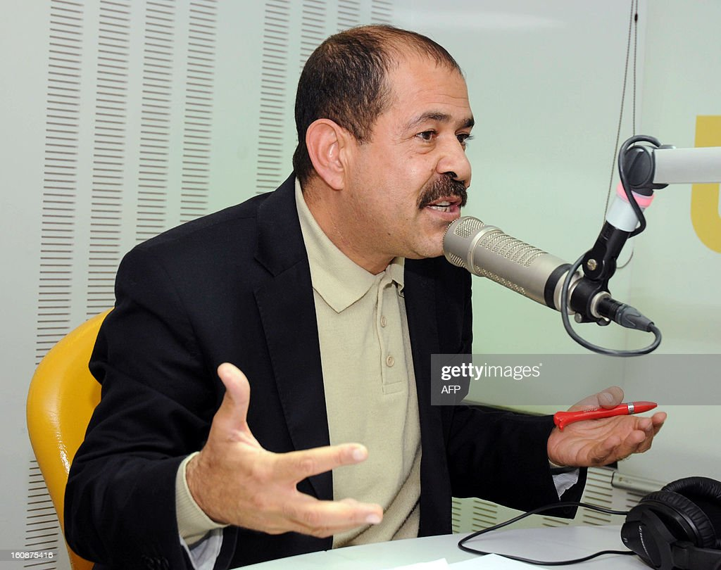 A picture taken on November 20, 2012 shows Tunisian lawyer and opposition leader Chokri Belaid speaking during a radio interview in Tunis. Chokri Belaid, who was gunned down outside his home on February 6, was a fierce opponent of Tunisia's ruling Islamists and a pan-Arab, left-wing activist propelled to the front of the political scene after the revolution.