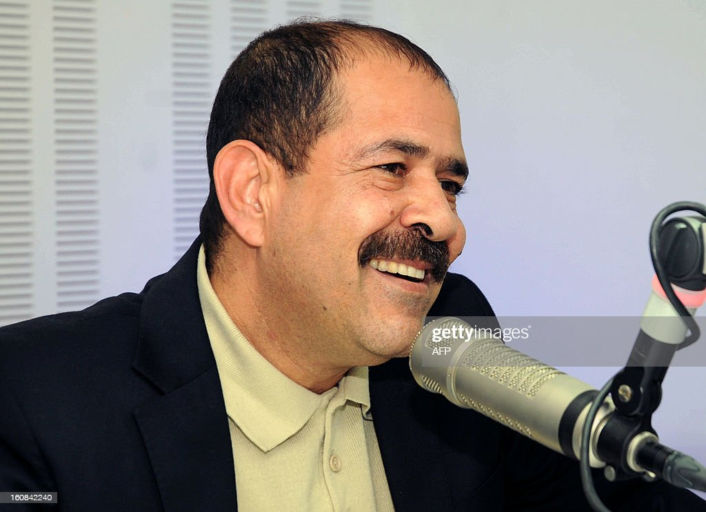 A picture taken on November 20, 2012 shows Tunisian lawyer Chokri Belaid speaking during a radio interview in Tunis. Prominent Tunisian opposition leader Chokri Belaid was gunned down outside his home in Tunis on February 6, 2013, sparking angry protests by his supporters and attacks on offices of the ruling Islamist Ennahda party. AFP PHOTO / KHALIL