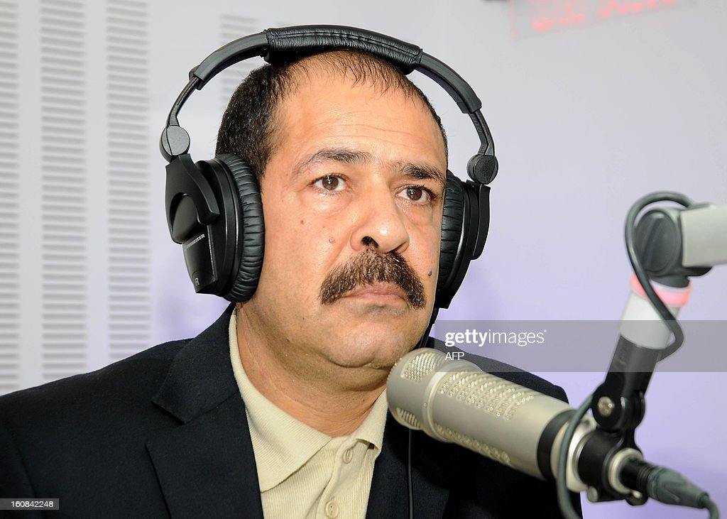 A picture taken on November 20, 2012 shows Tunisian lawyer Chokri Belaid during a radio interview in Tunis. Prominent Tunisian opposition leader Chokri Belaid was gunned down outside his home in Tunis on February 6, 2013, sparking angry protests by his supporters and attacks on offices of the ruling Islamist Ennahda party.