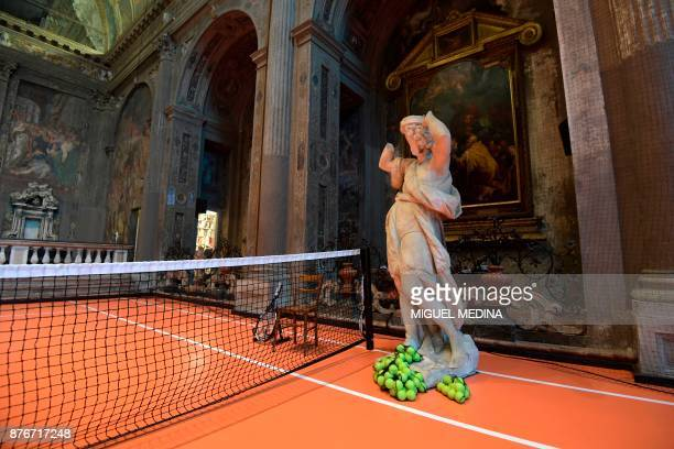 A picture taken on November 20 2017 shows US artist Asad Raza's new piece of art a tennis court called 'untitled ' inside the San Paolo Converso...