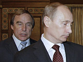 CORRECTION A picture taken on November 21 2009 shows then Russia's Prime Minister Vladimir Putin and Russian cellist Sergei Roldugin artistic...