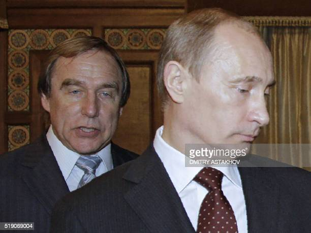 A picture taken on November 21 2009 shows then Russia's Prime Minister Vladimir Putin and Russian cellist Sergei Roldugin artistic director of the St...