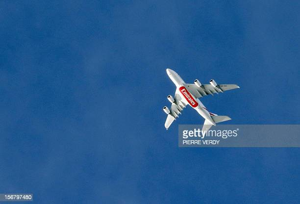 A picture taken on November 21 2012 shows a Emirates A380 airbus plane flying over Paris AFP PHOTO PIERRE VERDY