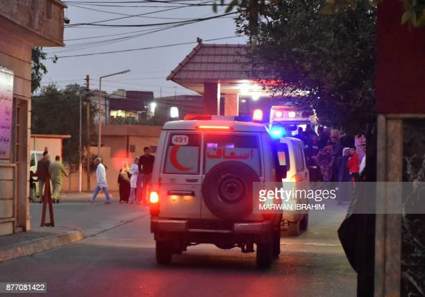 A picture taken on November 21 2017 shows ambulances driving in the northern Iraqi town of Tuz Khurmatu near Iraq's oilrich multiethnic province of...