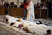 A picture taken on November 23 2014 shows archbishop of Granada Francisco Javier Martinez prostrating himself on the floor past other priests at the...