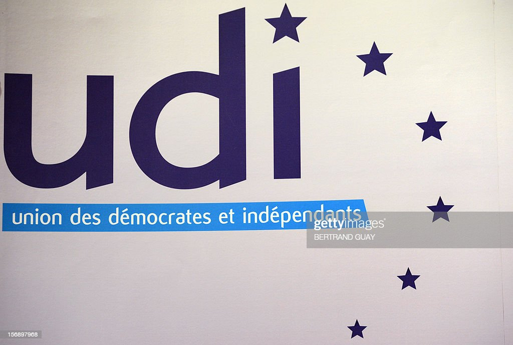 A picture taken on November 24, 12012 shows the logo of the Union of Democrats and Independents (UDI) party during a meeting with new members on November 24, 2012 at the 'Maison de la Mutualite' conference centre in Paris. France's centre-right UDI and far-right Front National (FN) recently declared registering an increasing number of new memberships since the bitterly contested leadership election of main opposition right-wing party Union for a Popular Movement (UMP).