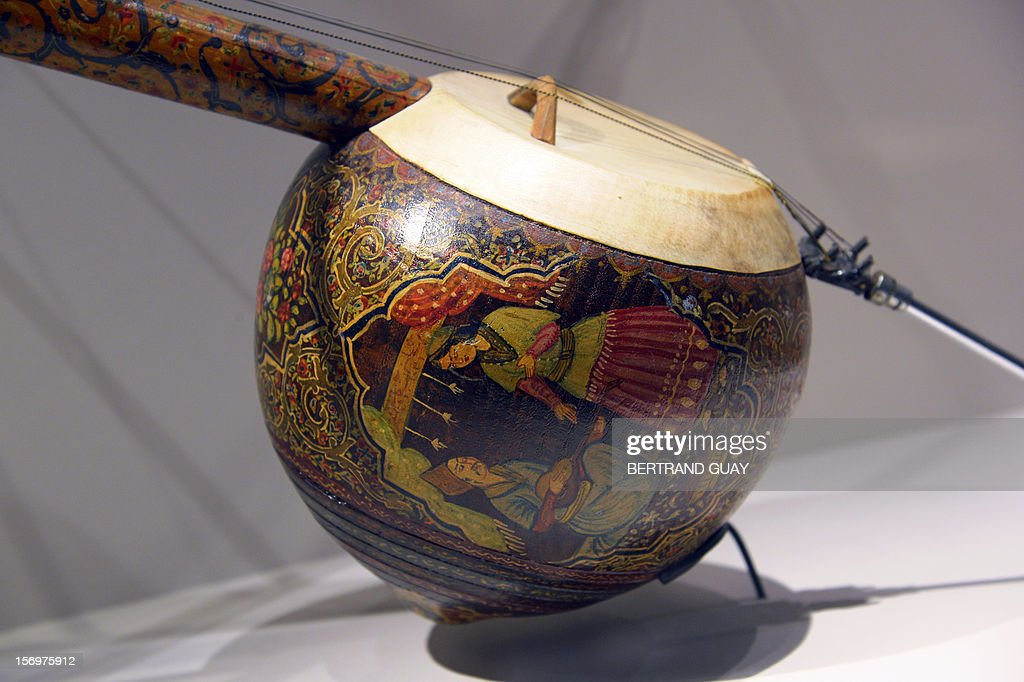 A picture taken on November 26, 2012 in Paris shows an Iranian fiddle displayed during the exhibition entitled 'Les Mille et une Nuits' (The thousand and one nights) at the Arab World Institute (IMA). The event runs until April 28, 2013.