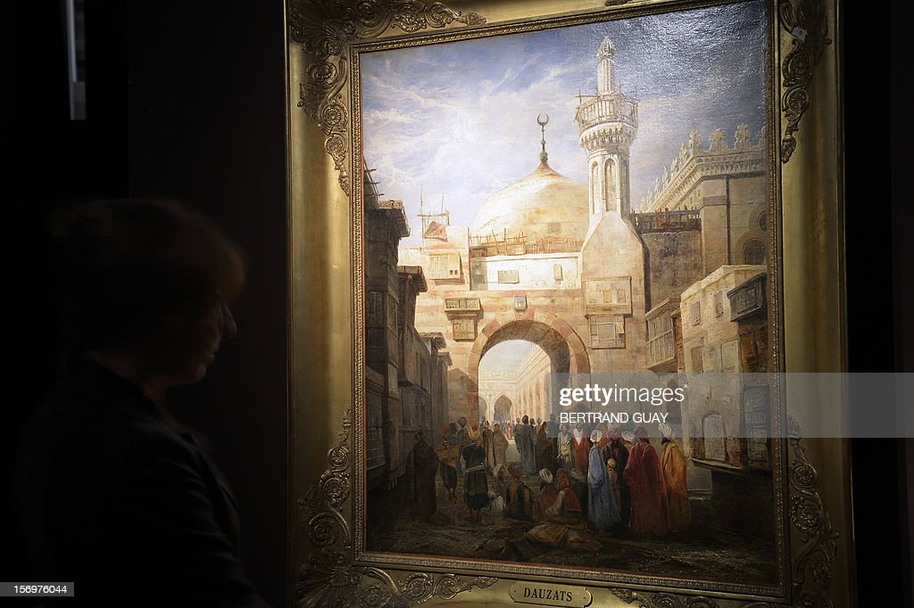 A picture taken on November 26, 2012 shows a painting by French artist Adrien Dauzats 'La mosque d'Al-Azhar au Caire' (The Al-Azhar mosque in Cairo) displayed during an exhibition entitled 'Les Mille et une Nuits' (The thousand and one nights) at the Arab World Institute (IMA) on November 26, 2012 in Paris. The event runs until April 28, 2013.