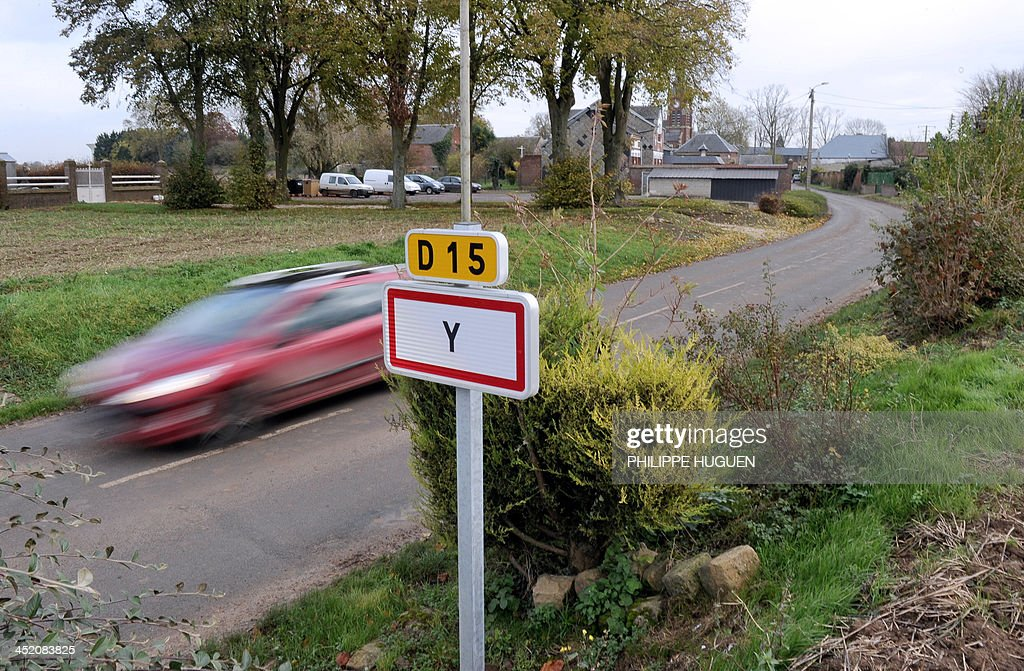 A picture taken on November 26, 2013 shows the entry sign of Y, French city with the shortest name. AFP PHOTO PHILIPPE HUGUEN