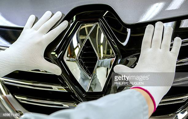 A picture taken on November 26 2014 shows the Renault logo on the new Espace car model at the French carmaker Renault's plant in Douai northern...