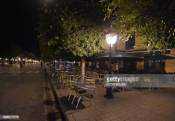 A picture taken on November 26 2015 early in the evening shows closed restaurants on Habib Bourguiba Avenue in the centre of Tunis due to a curfew...