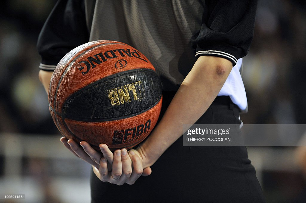 A picture taken on November 27, 2010 in Roanne shows a player holding a ball during the Pro A basketball match Roanne vs Vichy.
