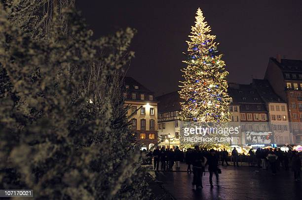 A picture taken on November 27 2010 shows a giant Christmas tree during the opening of the Strasbourg Christmas market which is the largest and one...