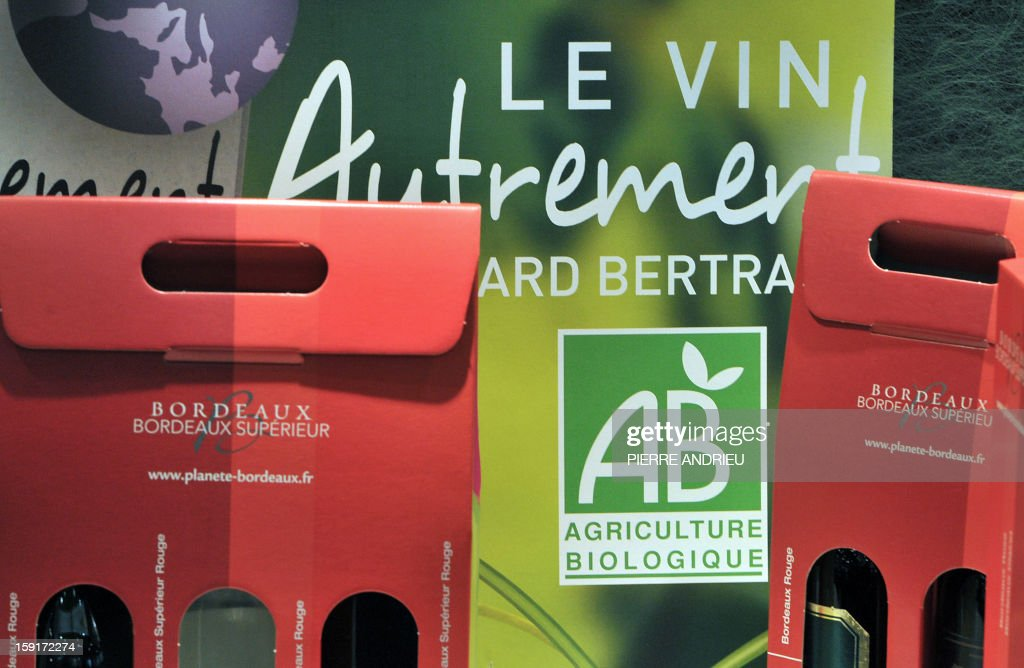 A picture taken on November 27, 2012 shows the logo of the 'AB' (Organic Farming) French certified label next to wine boxes of a French organic wine producer at the Vinitech professional wine fair in Bordeaux, southwestern France.