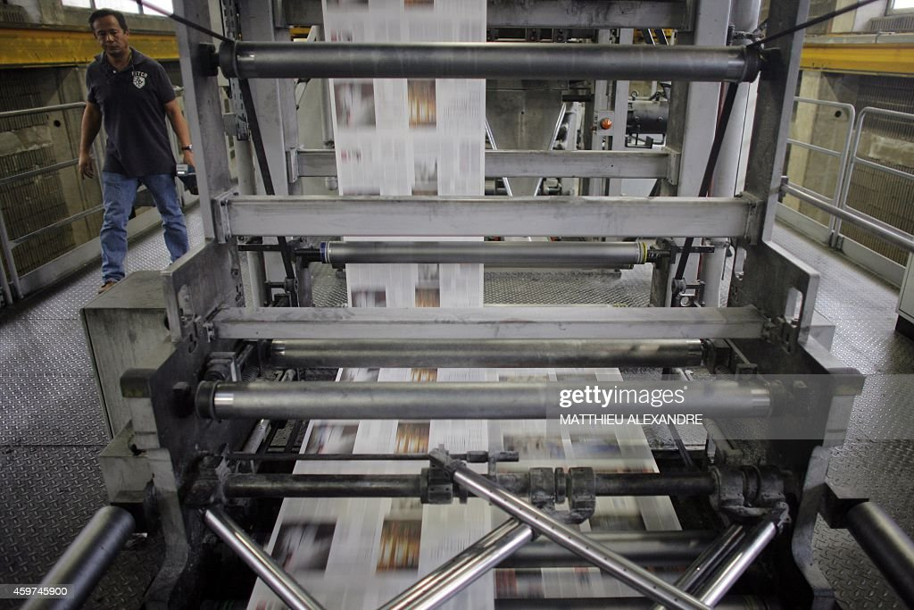 A picture taken on November 27 2014 in IvrysurSeine outside Paris shows the print house of the daily newspaper Le Monde Founded in 1944 Le Monde...