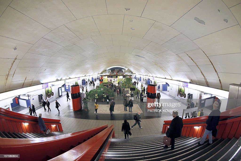 A picture taken on November 28, 2012 shows travellers walking down the stairs at the 'Auber' metro station in Paris.