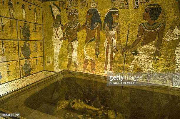 A picture taken on November 28 2015 shows the golden sarcophagus of King Tutankhamun displayed in his burial chamber in in the Valley of the Kings...