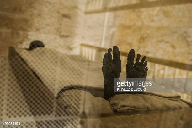 A picture taken on November 28 2015 shows the linenwrapped mummy of King Tutankhamun displayed in his climatecontrolled glass case in his underground...
