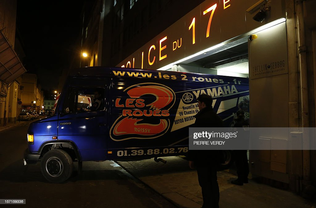A picture taken on November 29, 2012 in Paris shows a van arriving at the Hotel de Police of the 17th district to pick up the motorbike of French actor Gerard Depardieu. Depardieu was in hot water again when he was arrested after testing positive for alcohol after a minor scooter accident in Paris. When police arrived at the scene and tested him, he showed a blood alcohol level of 1.8 grams per litre, well above the French limit for driving of 0.5. Depardieu was detained and brought to a police station where he could face misdemeanor charges 'after a period of sobering up,' the source said.