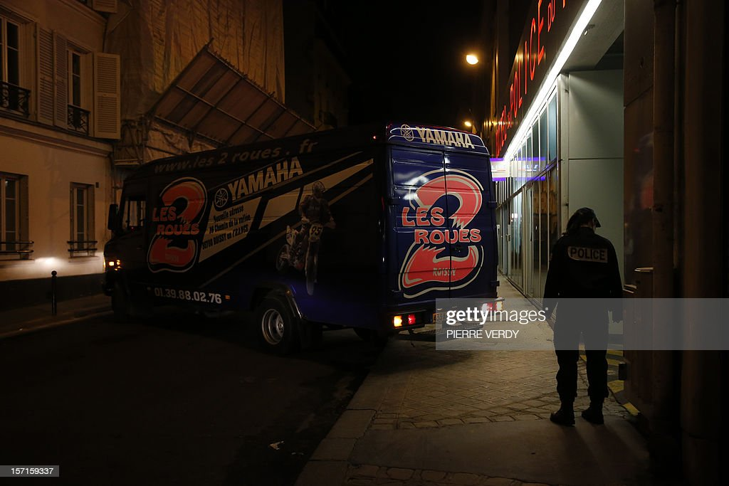 A picture taken on November 29, 2012 in Paris shows a van arriving at the Hotel de Police of the 17th district to pick up the motorbike of French actor Gerard Depardieu. Depardieu was in hot water again when he was arrested after testing positive for alcohol after a minor scooter accident in Paris. When police arrived at the scene and tested him, he showed a blood alcohol level of 1.8 grams per litre, well above the French limit for driving of 0.5. Depardieu was detained and brought to a police station where he could face misdemeanor charges 'after a period of sobering up,' the source said. AFP PHOTO PIERRE VERDY