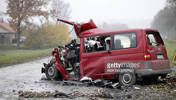 A picture taken on November 3 2010 shows the wreckage of a coach registered in Poland after its collision with a tractor on November 3 2010 near...
