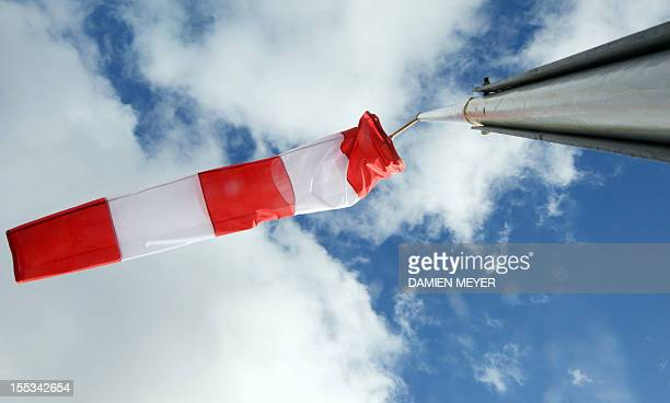 A picture taken on November 3 2012 shows a windsock in the harbour of Les Sables d'Olonne western France The 7th edition of the Vendee Globe solo...