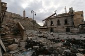 A picture taken on November 3 2014 shows heavily damaged buildings outside the wall of Aleppo's UNESCOlisted citadel The 5000yearold citadel which...