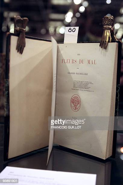 A picture taken on November 30 2009 in Paris shows an original copy of the book 'Les Fleurs du mal' by Charles Baudelaire Personal letters first...