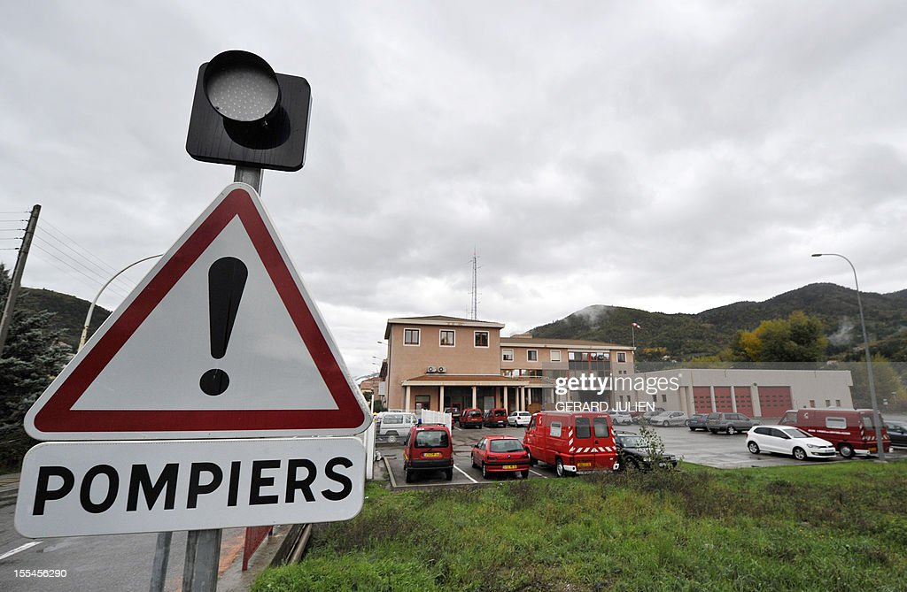 A picture taken on November 4, 2012 in Digne-les-Bains, southeastern France, shows a roadsign warning the entrance of the firehouse where two volunteer firefighters, including a 16-year-old man, who both died the day before while trying to extinguish a fire in Digne-les-Bains, were based.