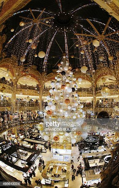 A picture taken on november 4 2015 shows a christmas tree at the Galeries Lafayette Paris department store in Paris AFP PHOTO / FRANCOIS GUILLOT