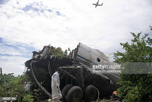 A picture taken on November 4 2015 shows part of a cargo plane that crashed into a farming community on an island on the White Nile river close to...