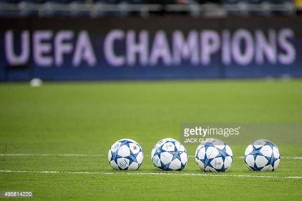 A picture taken on November 4 shows balls on the pitch before the start of the UEFA Champions League group G football match between Maccabi Tel Aviv...