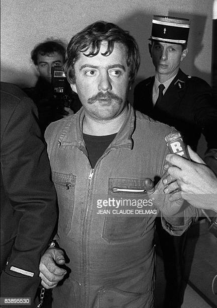 A picture taken on November 5 1985 shows Bernard Laroche flanked by two French gendarmes arriving at the Epinal court house eastern France A French...
