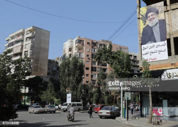 A picture taken on November 5 2017 shows a banner bearing a portrait of Lebanon's Hezbollah chief Hasan Nasrallah in the capital Beirut / AFP PHOTO /...