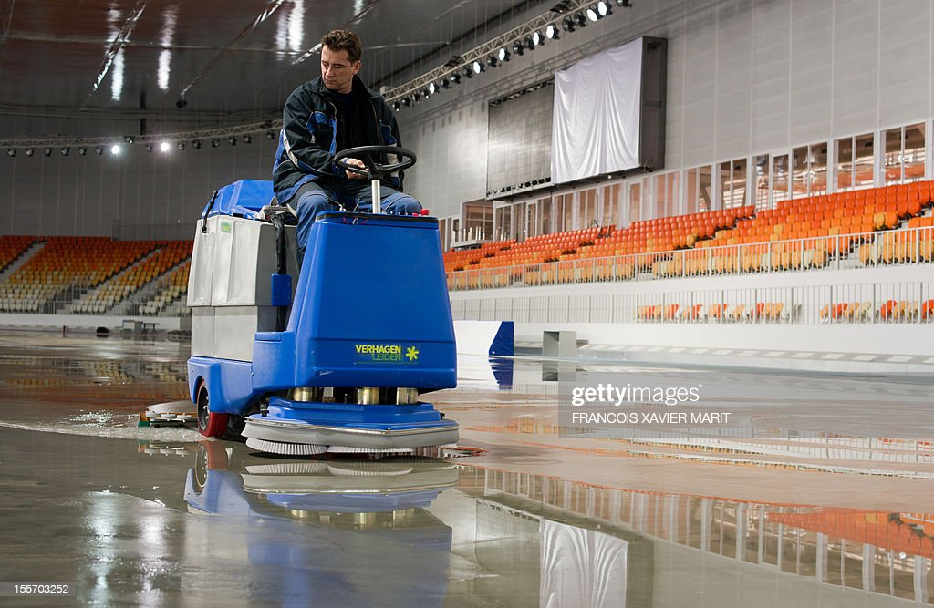 A picture taken on November 6, 2012 shows a man cleaning the track at the newly constructed Adler arena, part of the coastal cluster in Sochi which will host the speed skating events at the upcoming 2014 winter olympics. MARIT