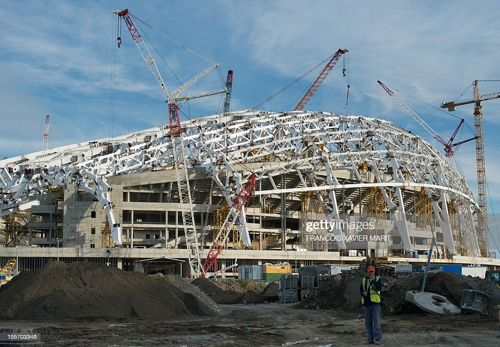 A picture taken on November 6, 2012 shows a workman standing by the fisht olympic stadium which will host the opening and closing ceremonies at the upcoming 2014 winter olympics in Sochi. MARIT