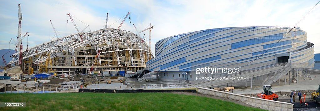 A picture taken on November 6, 2012 shows the fisht olympic stadium (L) which will host the opening and closing ceremonies and the Shayba arena which will host ice hockey matches at the upcoming 2014 winter olympics in Sochi. MARIT