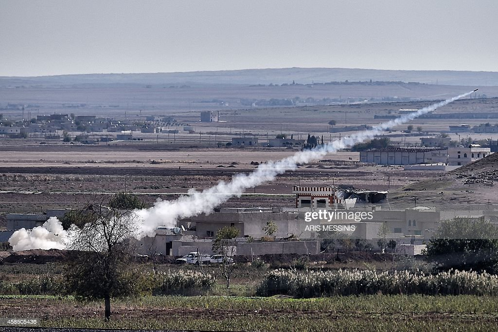 A picture taken on November 6 2014 from the Turkish city of Mursitpinar shows a rocket fired by Islamic State militants to People's Protection Units...