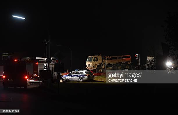 A picture taken on November 6 2015 shows police and firefigther vehicles next to a heavy lorry which collided with a regional train at a crossing...