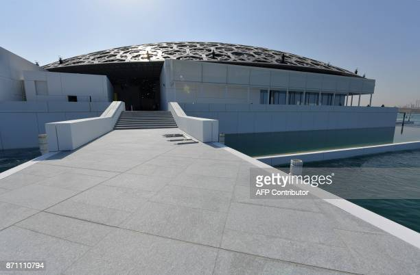 A picture taken on November 6 2017 shows part of the Louvre Abu Dhabi Museum designed by French architect Jean Nouvel during a media tour prior to...
