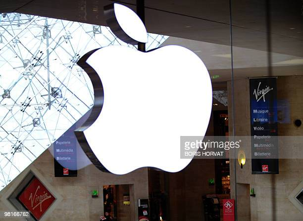 Picture taken on November 7 2009 shows Apple Store logo next to Virgin logo on the opening day of France's first US technology Apple Store inside the...