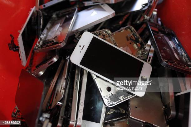 A picture taken on November 7 2014 in Brive southern France shows smartphones screens in the Love2recyclefr recycling company The company collects...
